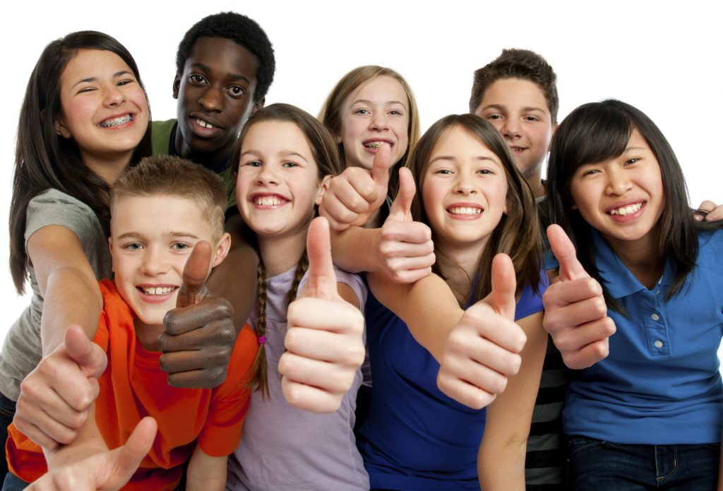 Twelve and thirteen year old diverse group on a white background